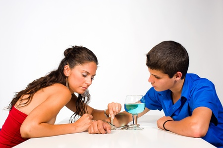 Woman unchaining a teenager from his alcohol addiction photo