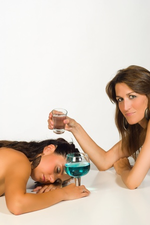 Woman after a few drinks too many being woken up by a friend photo