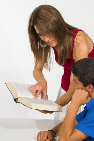 Sudent getting help from a female teacher Stock Photo - 9976422