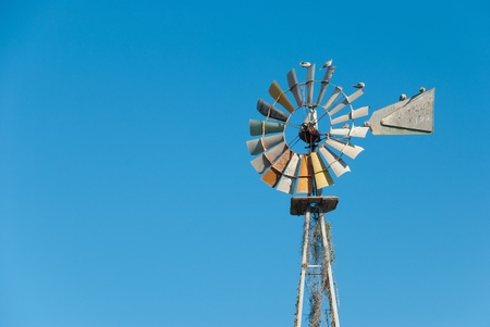 traditional windmill: Traditional windmill pump extracting water from a well Stock Photo