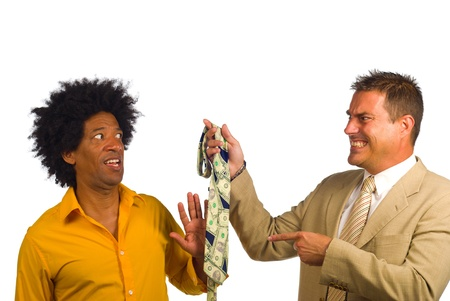 conventional: Bohemian artist type of guy under pressure to wear a tie Stock Photo