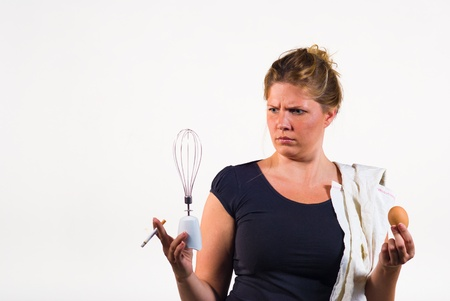 frowzy: A messy woman totally overwhelmed when having to deal with an egg