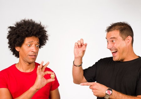 Guys making fun of each other because of measurements Stock Photo