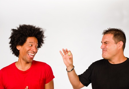 embarassment: Guys making fun of each other because of measurements Stock Photo