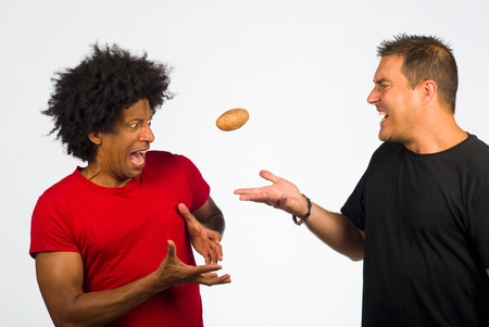 unwanted: Passing on the hot potato Stock Photo