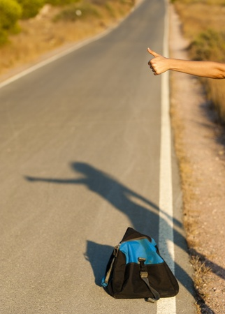 fugitive: A hand and the shade of a sexy female hitchhiker