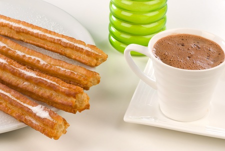 churros: Fresh churros served with hot chocolate, traditional Spanish breakfast Stock Photo