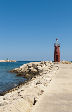 breakwaters: Harbor breakwaters with the two beacon lighthouses