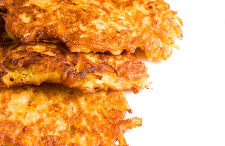 Freshly fried  crunchy golden latkes, traditional food photo