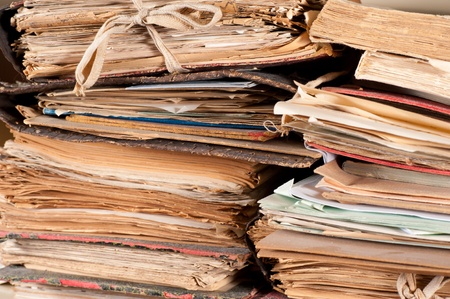 A stack of old files yellowing in an archive photo