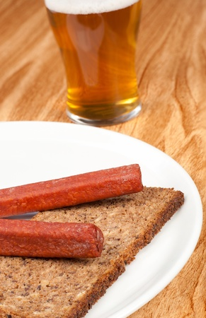 pumpernickel: Traditional German landjaeger sausage with a glass of beer