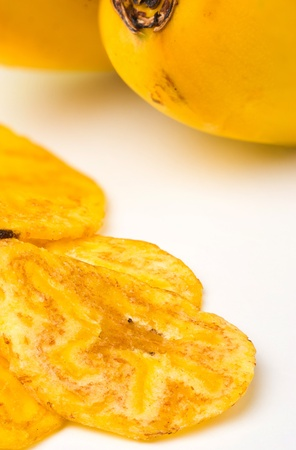 Fried thinly sliced banana chips, a tropical snack photo