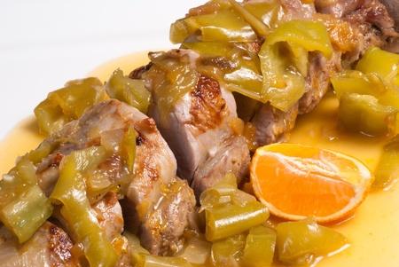 Roast pork sirloin in a fruity orange sauce photo