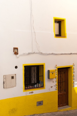 Charmingly renovated facade of a traditional Mediterranean house photo