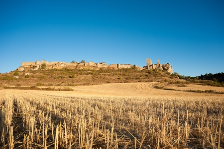 The fortified town of Calatanazor, amidst harvested autumn fields Stock Photo - 10913266