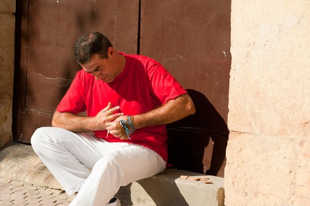 Traditional Spanish pelota player ritually wrapping his fingers in plaster protections Stock Photo - 10973361
