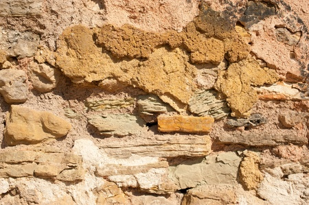 A weathered adobe and stone wall, a background Stock Photo - 11097111
