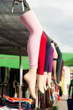 street market: Street market stall offering colorful stockings displayed on mannequin legs