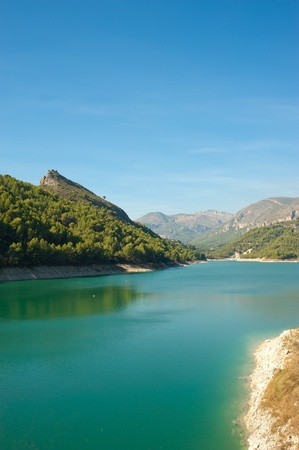 opalescent: Guadalest reservoir with its landmark turquoise waters