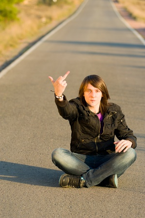 hinder: Young male demonstrating and showing his displeasure Stock Photo