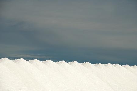 saltmine: Huge amounts of product on a salt mine yard Stock Photo