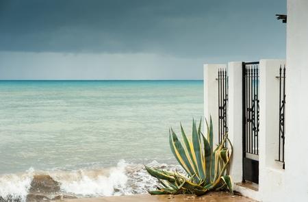 Idyllic Mediterranean beachfront house on a  stormy day Stock Photo - 11316210