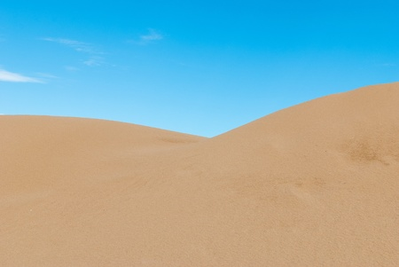 Golden sand and blue sky, abstract background photo