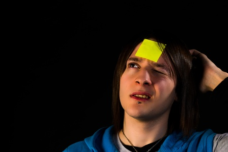 Forgetful guy with a sticky note on his forehead, a concept Stock Photo - 11537376