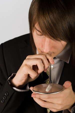 snort: Guy about to snort a line of cocaine