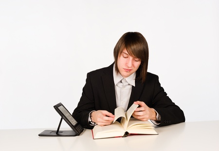 Student unable to get used back to a traditional book Stock Photo - 12101992