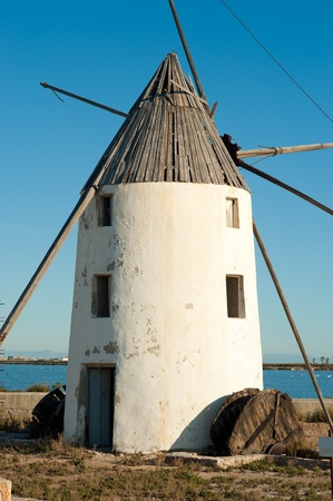 Old windmill amidst the salt marshes  of San Pedro del Pinatar, Costa Calida, Spain photo