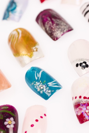 A variation of acrylic fingernails with creative designs