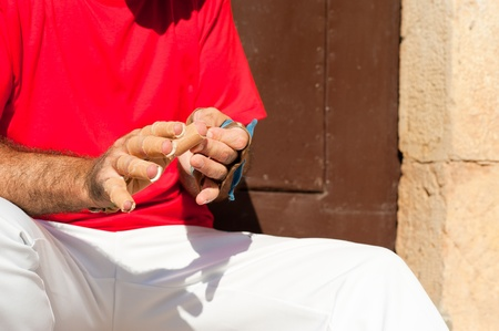 Pelota player wrapping his fingers in protective plasters Stock Photo - 12679540