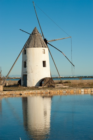 Traditional windmill amids the salt mines in San Pedro, Murcia, Spain