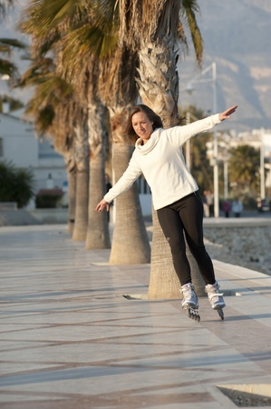 Skillful performance on her rollerskates Stock Photo - 12617283
