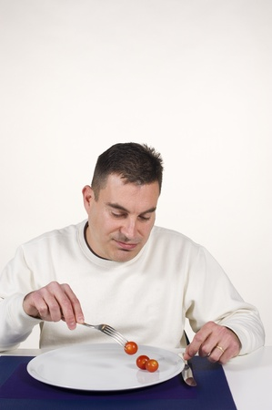Guy suffering with his dieting discipline Stock Photo - 12626387