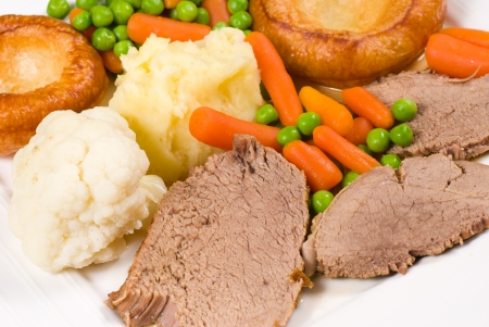 Roast beef, vegetables and Yorkshire pudding Stock Photo