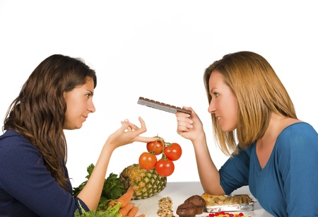 health conscious: Health conscious eating or  giving in to treats