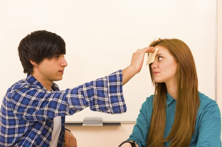 Getting a sticky note on the forehead, a concept Stock Photo