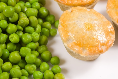 english food: Pies served with peas, traditional English food