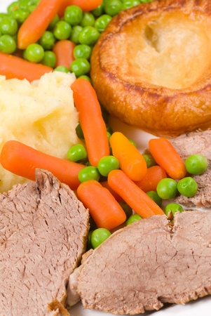 Traditional English lunch, roast beef, vegetables and Yorkshire pudding photo
