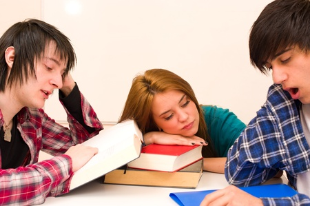 unmotivated: Unmotivated students sitting around their books