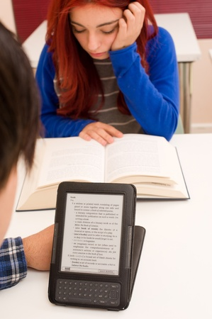 Students reading in two different formats Stock Photo - 13335389