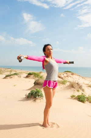 Enjoying the morning with exercises on the beach photo