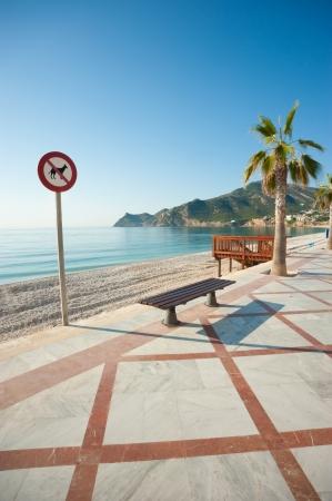albir: Sign forbidding dogs on a sunny resort beach