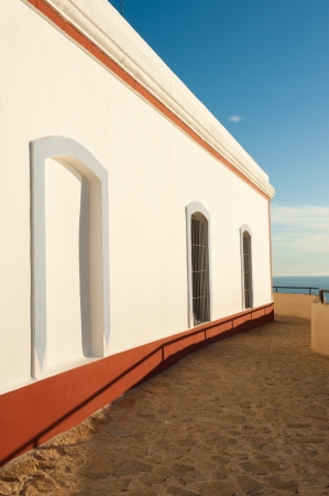 albir: Whitewashed wall on a scenic location looking over the ocean