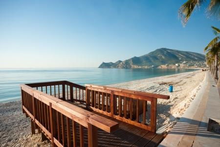 albir: Wooden walkway to access a sunny Mediterranean beach