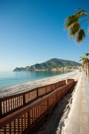 albir: Ease of access to a sunny Mediterranean resort beach Stock Photo