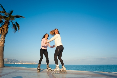 Trying things on skate, two friends having fun photo
