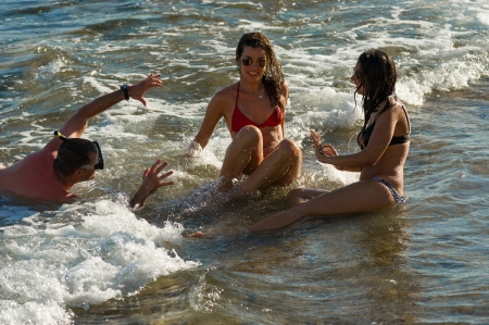 molest: Summertime, bikinis and stalking men, a tradition Stock Photo